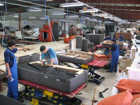 Nepali Uphosleters working at furniture factory in Poland