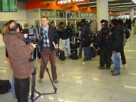 Nepali workers being interviewed by TV reporters in Poland